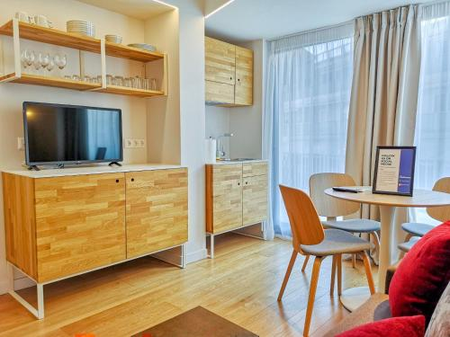 A television and/or entertainment center at Olala Syntagma Apartments
