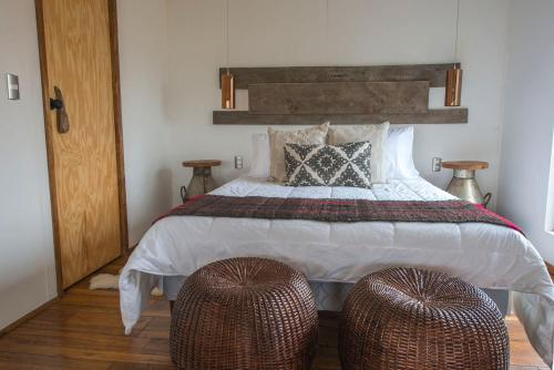 A bed or beds in a room at Toore Patagonia