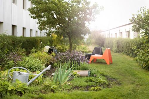 A garden outside Hotel Garden