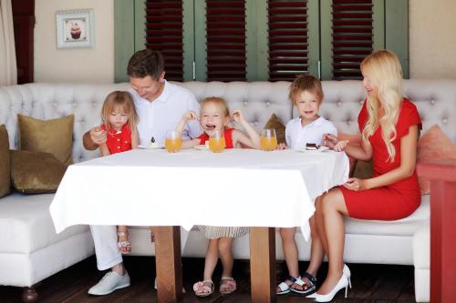 A family staying at Alean Family Resort & SPA Doville 5* Ultra All Inclusive