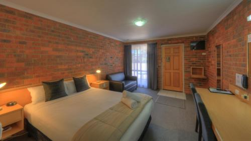 A bed or beds in a room at Pevensey Motor Lodge