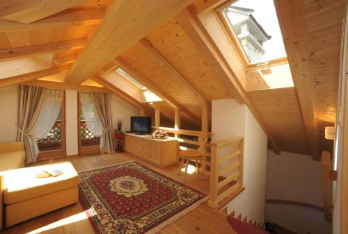 A television and/or entertainment center at Romantic Chalet Dolomiti