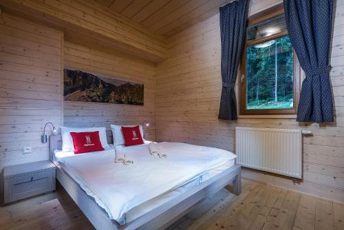 A bed or beds in a room at Hotel Björnson Jasná & Björnson TREE HOUSES