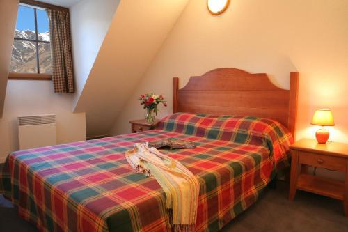Un ou plusieurs lits dans un hébergement de l'établissement Résidence Néméa Les Chalets d'Estive