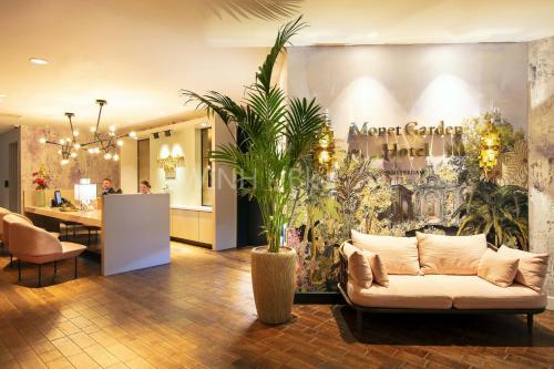 De lobby of receptie bij Monet Garden Hotel Amsterdam