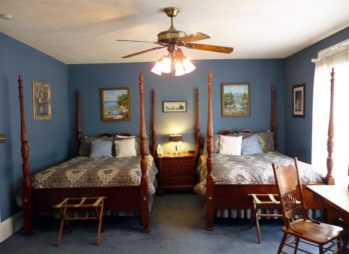 A bed or beds in a room at Strickland Arms Bed and Breakfast