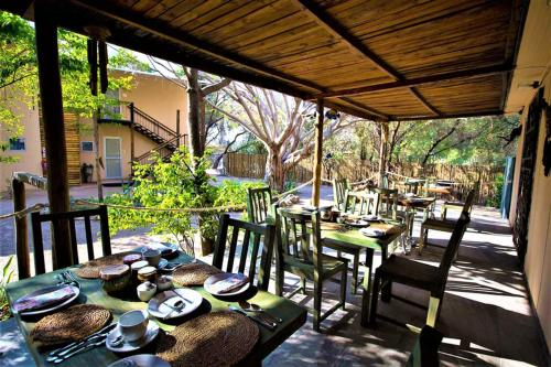 A restaurant or other place to eat at The Waterfront, Maun