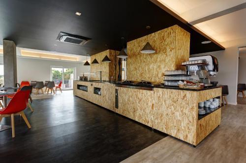 A cozinha ou kitchenette de Sport Hotel Gym + SPA
