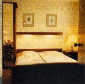 Ein Bett oder Betten in einem Zimmer der Unterkunft Hotel de Admiraal