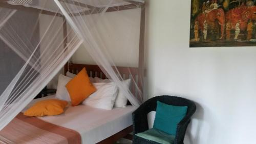 A bed or beds in a room at The Secret Guesthouse