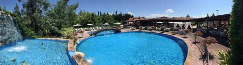 A view of the pool at Relais Madonna di Campagna or nearby