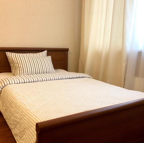 Кровать или кровати в номере Апартаменты на Большой Очаковской