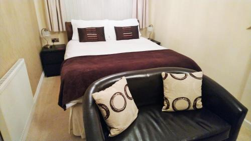 A bed or beds in a room at The Windsor Blackpool
