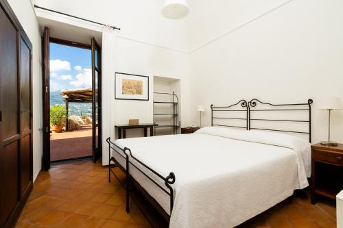 A bed or beds in a room at Albergo Il Monastero