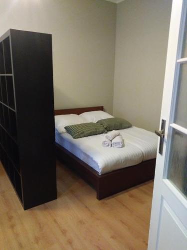Łóżko lub łóżka w pokoju w obiekcie AP Na Groblach