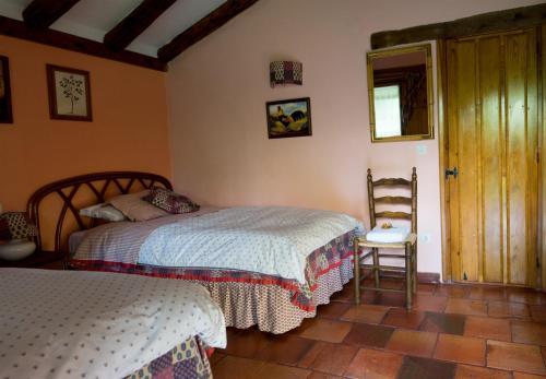 A bed or beds in a room at La Tejera de Fausto