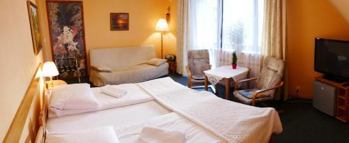 Łóżko lub łóżka w pokoju w obiekcie Apartament w Willi Busola