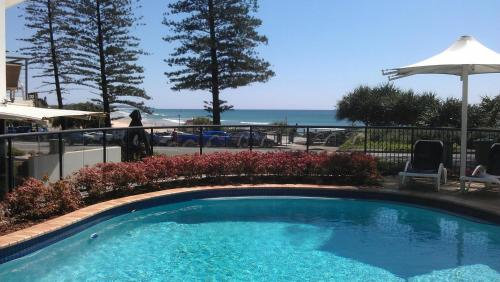 The swimming pool at or near The Beach Retreat Coolum