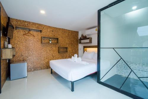 A bed or beds in a room at Beach Box Resort Hua Hin