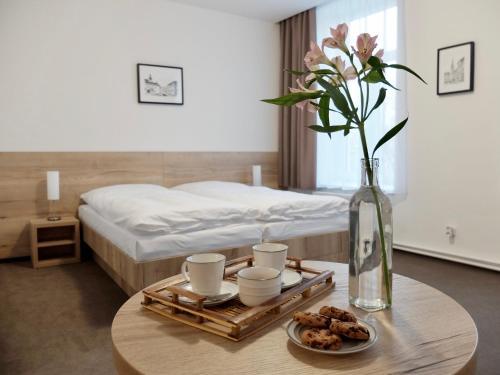 Postel nebo postele na pokoji v ubytování Penzion Stará pošta