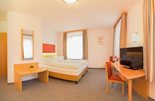 Ein Bett oder Betten in einem Zimmer der Unterkunft Hotel Gasthof Stefansbrücke
