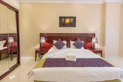 Cama ou camas em um quarto em Taleen Al Naseem