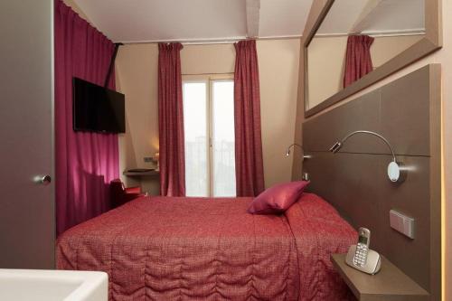 Letto o letti in una camera di Hotel Minerve