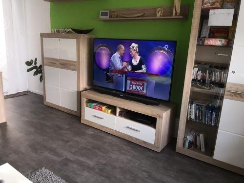 A television and/or entertainment centre at Boutique-Apartment-Duisburg