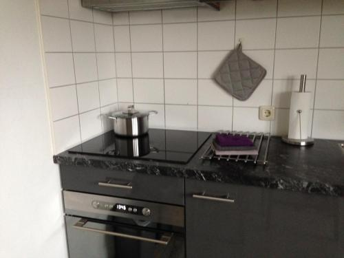 Een keuken of kitchenette bij Paal 5