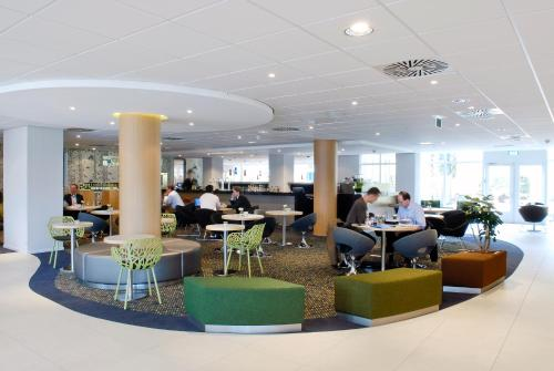 A restaurant or other place to eat at Novotel Eindhoven