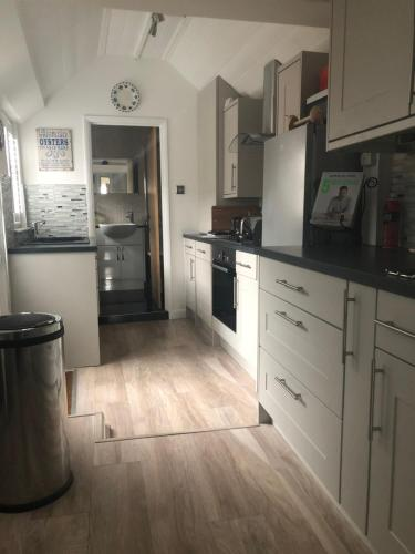 A kitchen or kitchenette at Marine Cottage