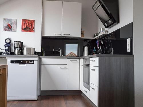 A kitchen or kitchenette at Bed And Rooms