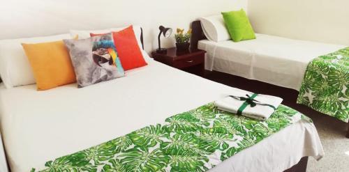 Кровать или кровати в номере Hotel Tropical