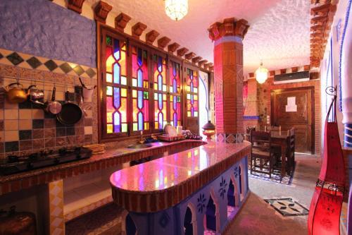 El salón o zona de bar de Résidence Hoteliére Chez Aziz