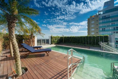 A piscina localizada em Hotel Laghetto Stilo Higienópolis ou nos arredores