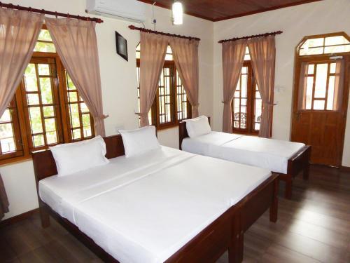 Un ou plusieurs lits dans un hébergement de l'établissement Riviera Resort