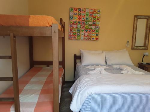 Cama ou camas em um quarto em Pousada Casa das Rosas