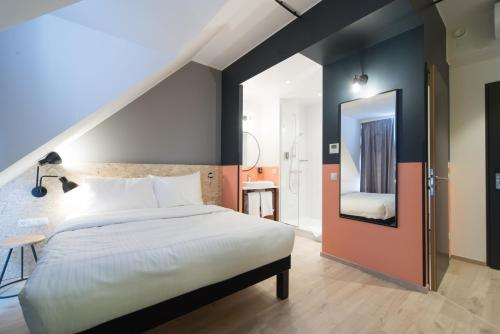 A bed or beds in a room at ibis Styles Wien Messe Prater