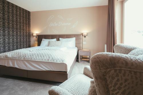 Ein Bett oder Betten in einem Zimmer der Unterkunft Maiers Hotel Schlafgut