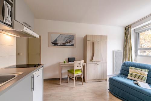 A kitchen or kitchenette at Lagrange Apart'Hotel l'Escale Marine