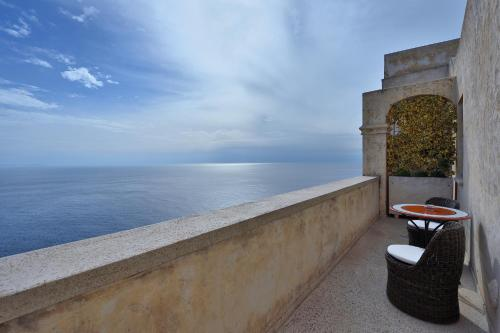 A balcony or terrace at Monastero Santa Rosa Hotel & Spa