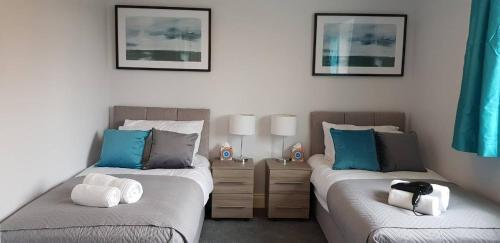 A bed or beds in a room at Delight Marvel - Cades Place