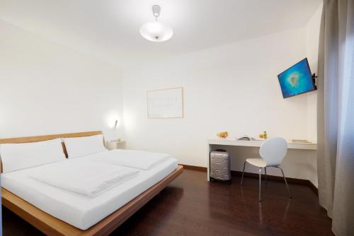 A bed or beds in a room at Hotel Asterix