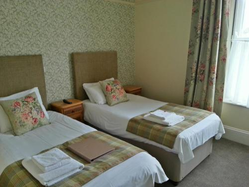 A bed or beds in a room at George Hotel