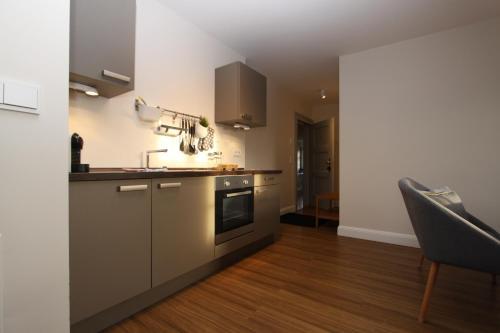 A kitchen or kitchenette at Apartment Am Völkerschlachtdenkmal