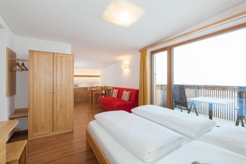 Ein Bett oder Betten in einem Zimmer der Unterkunft Residence Aichner