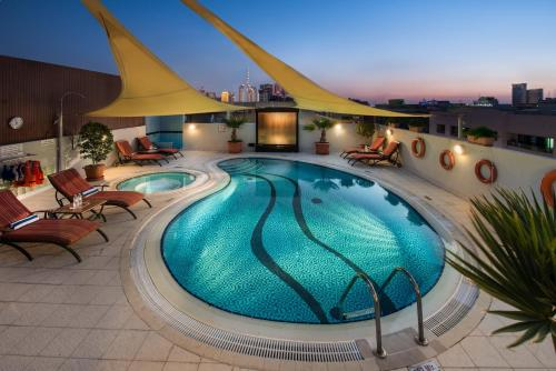 The swimming pool at or near Savoy Suites Hotel Apartment