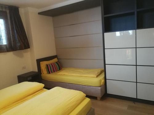 Postel nebo postele na pokoji v ubytování Chalet Mottolino