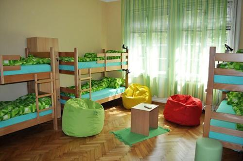 A bunk bed or bunk beds in a room at Habitat Hostel