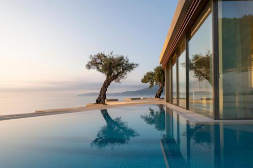 The swimming pool at or near Domes Miramare, a Luxury Collection Resort, Corfu - Adults Only